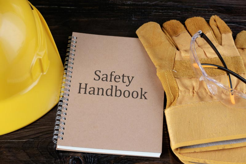 safety PPE equipment placed on a wooden bench