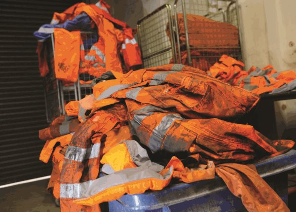 phs besafe pile of dirty hi visibility workwear